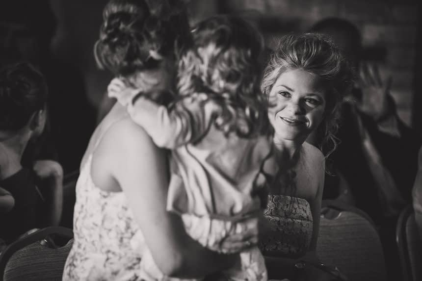 guest smiling at flower girl