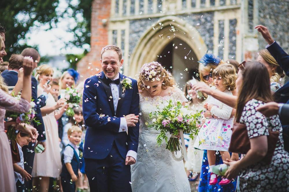 bride and groom confetti walk