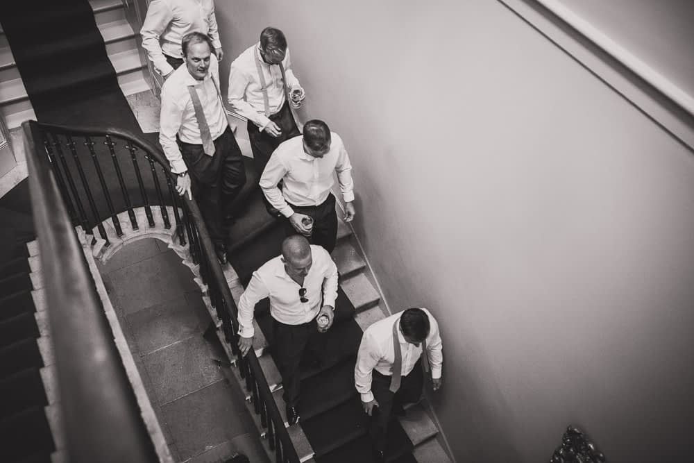 groomsmen walking down stairs