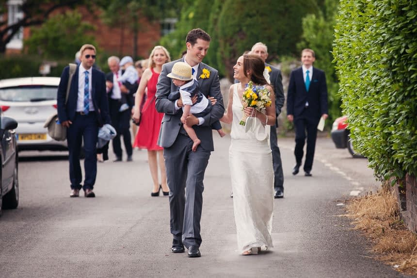 Bride, Groom and their son walking back from the church, colour photo