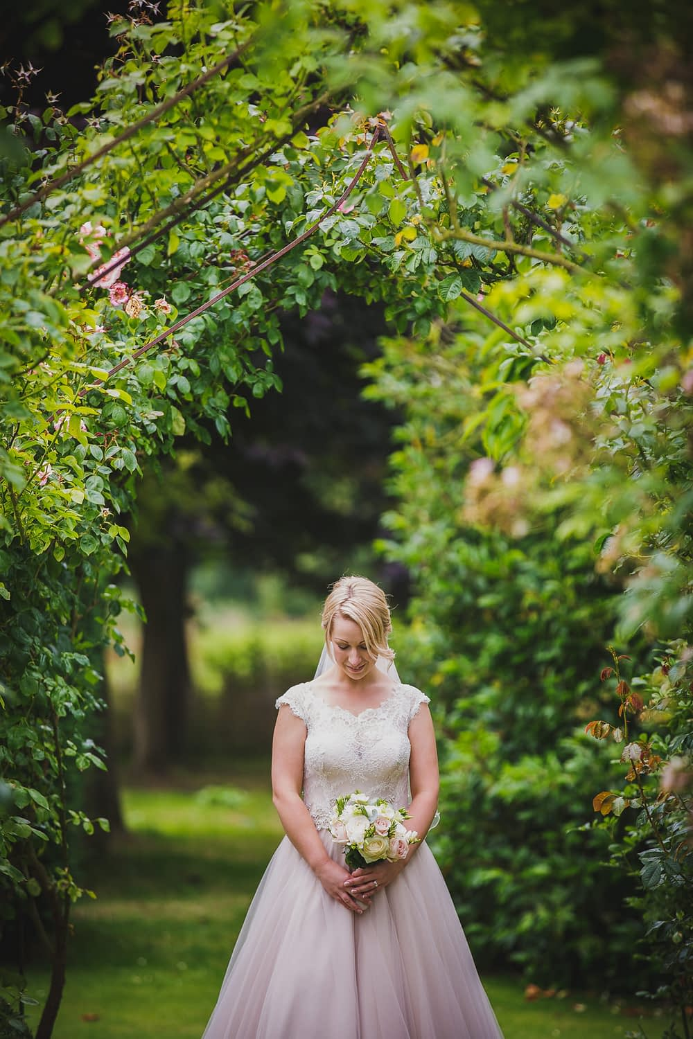 bride with flowers looking down