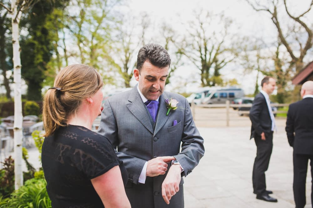 groom checking watch