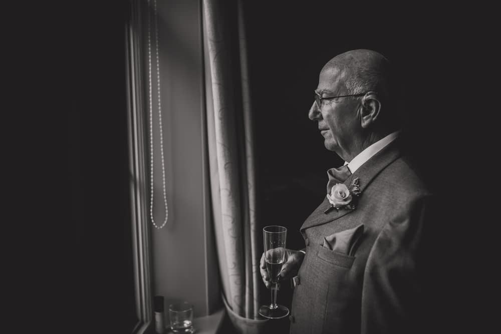 father of bride looking out window