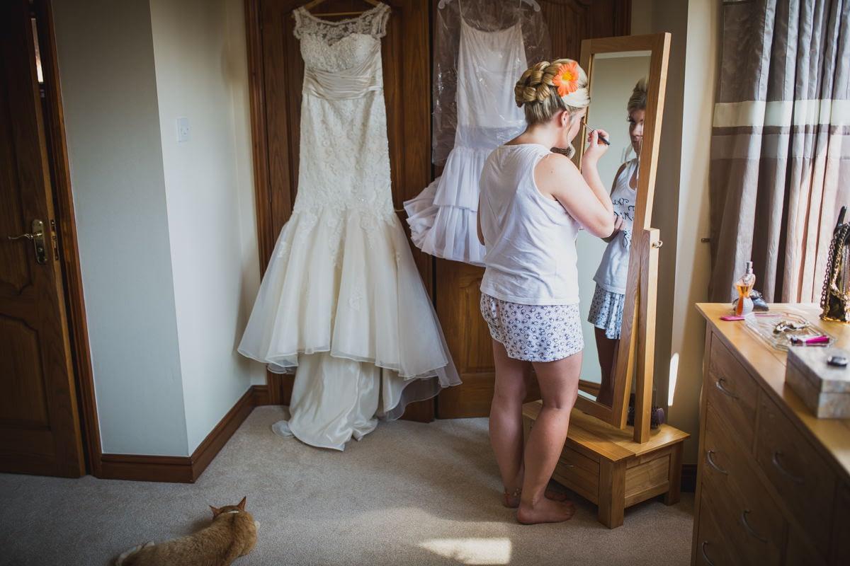 bride standing in front of mirror