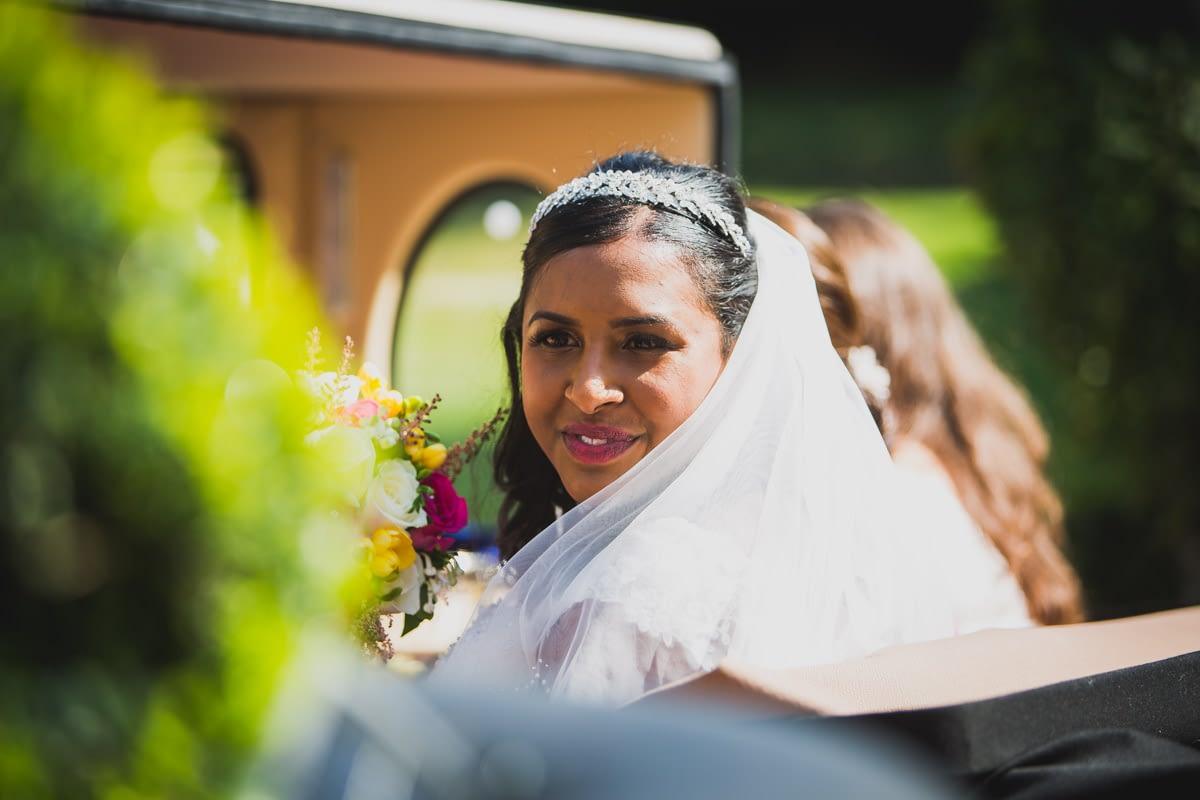 bride in back of wedding car