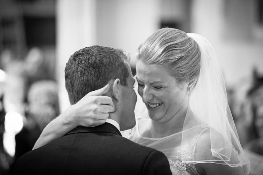 laughing bride just after first kiss