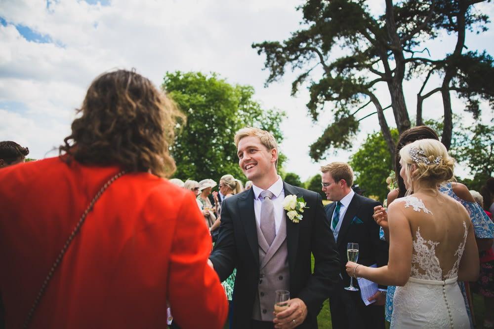 groom shaking hands