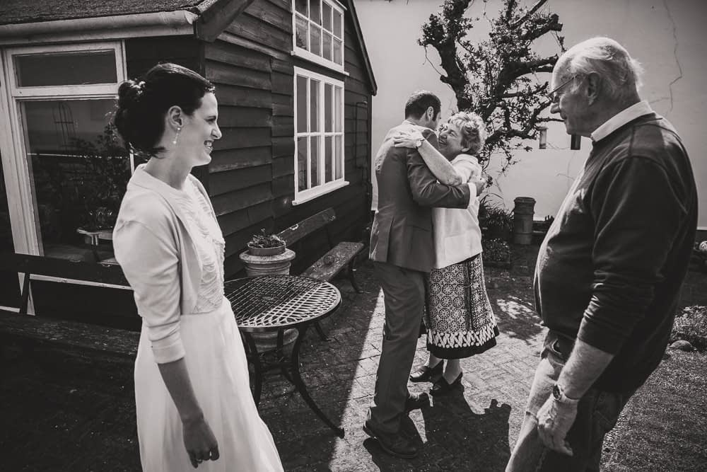 groom hugging relatives