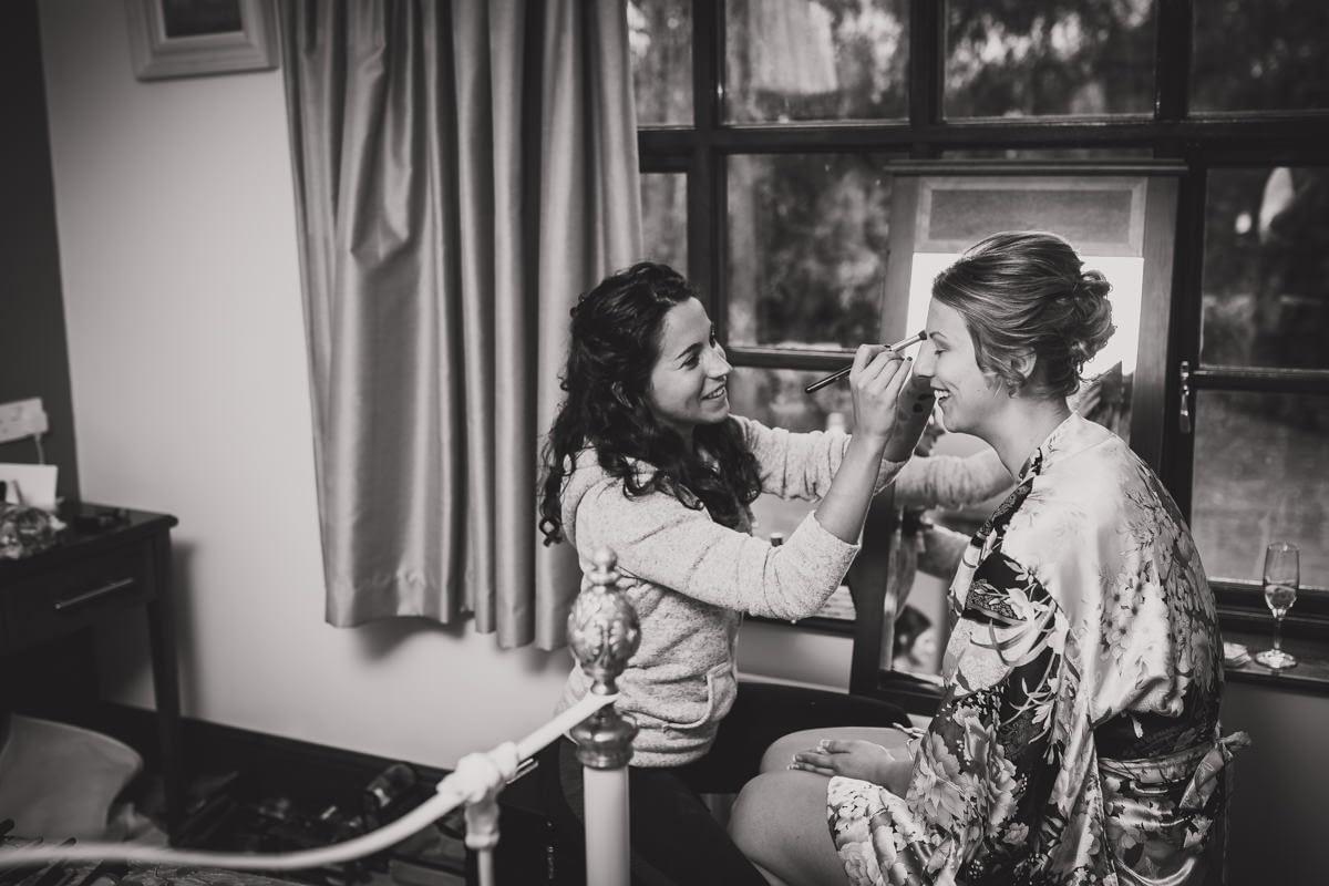 bridesmaid having make up done
