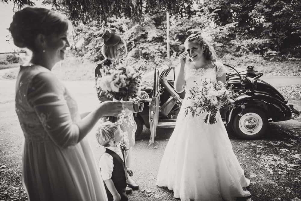 bride wiping happy tear away