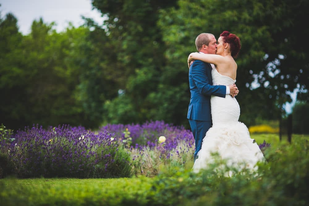 bride and groom kissing in garden