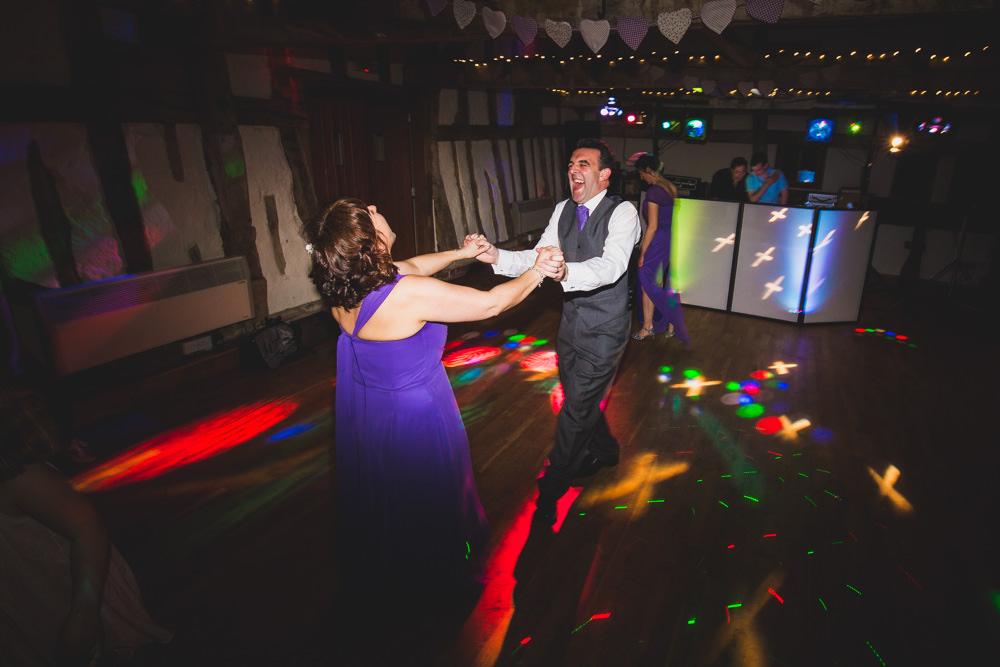 groom and bridesmaid dancing