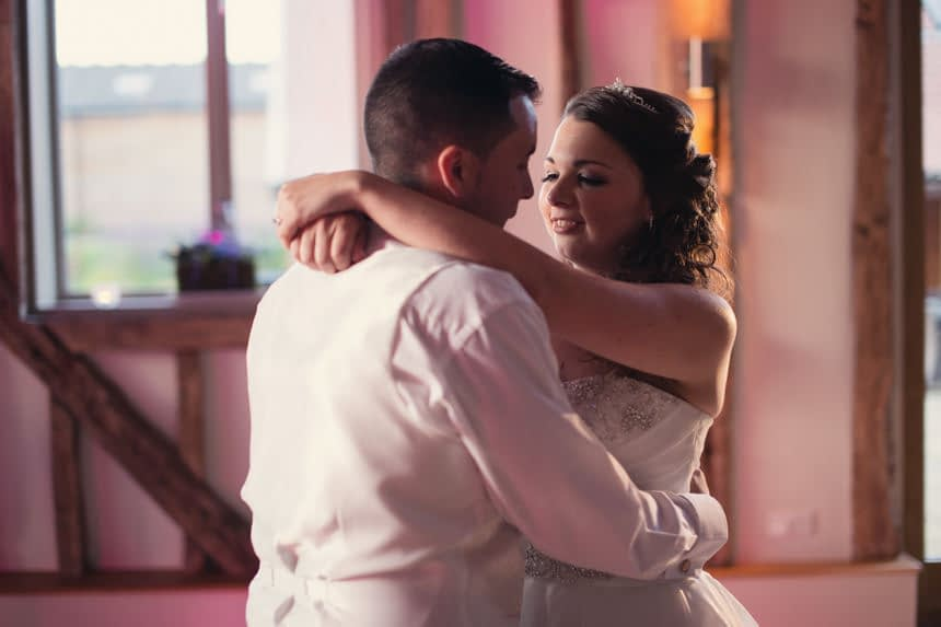 bride and groom hug on dance floor