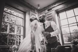 groom toasting wife