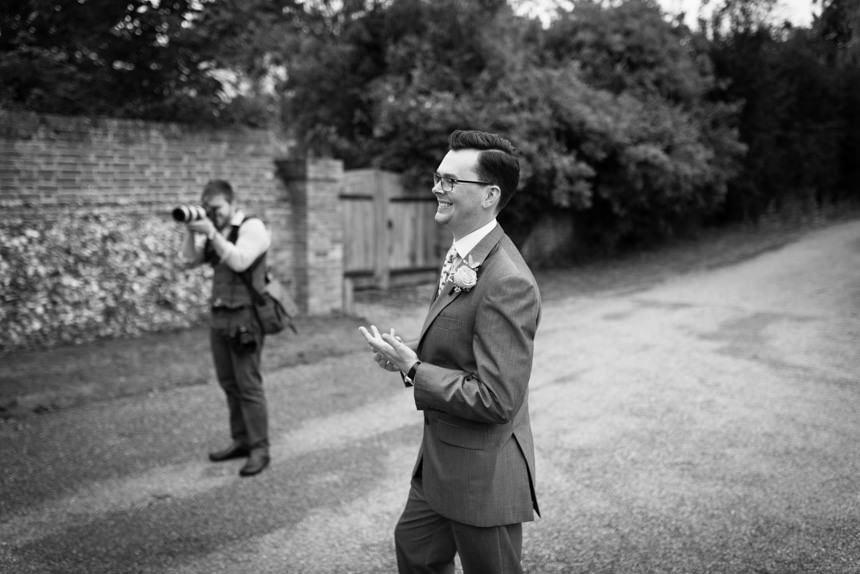 groom laughing at bride