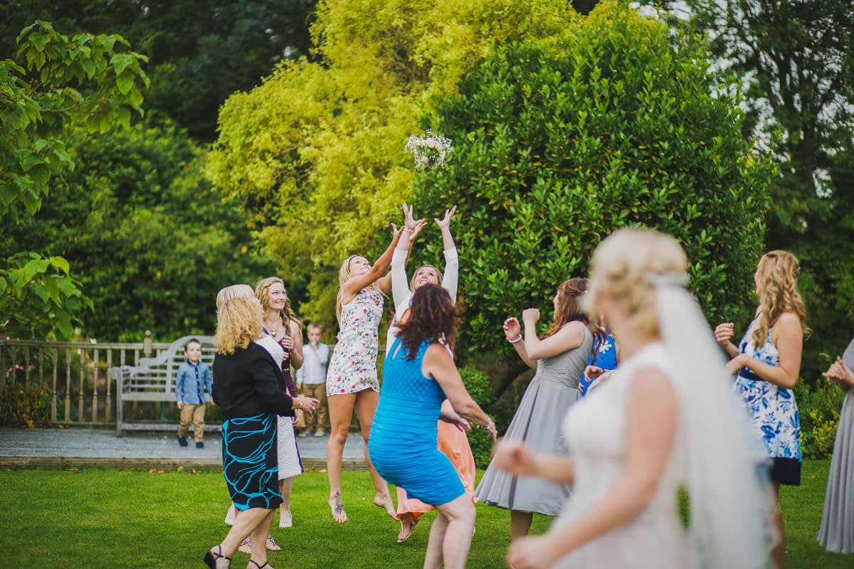 ladies jumping for bouquet
