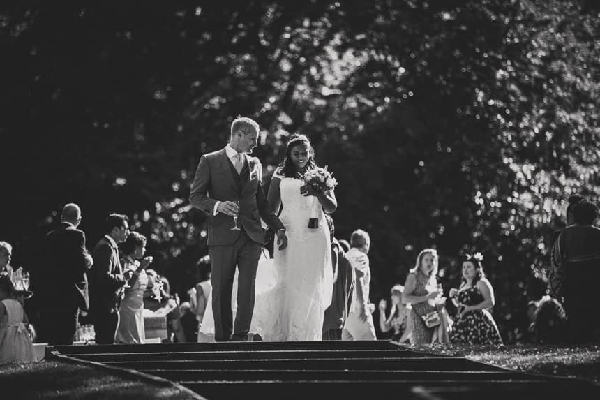 bride and groom at top of stairs