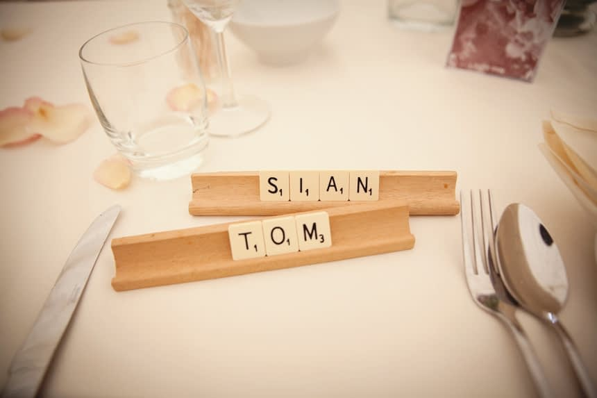 Scrabble tiles spelling out couples name at top table