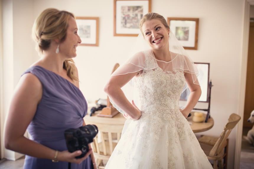 bride smiling at sister