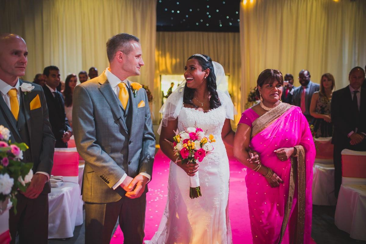 bride reaching groom