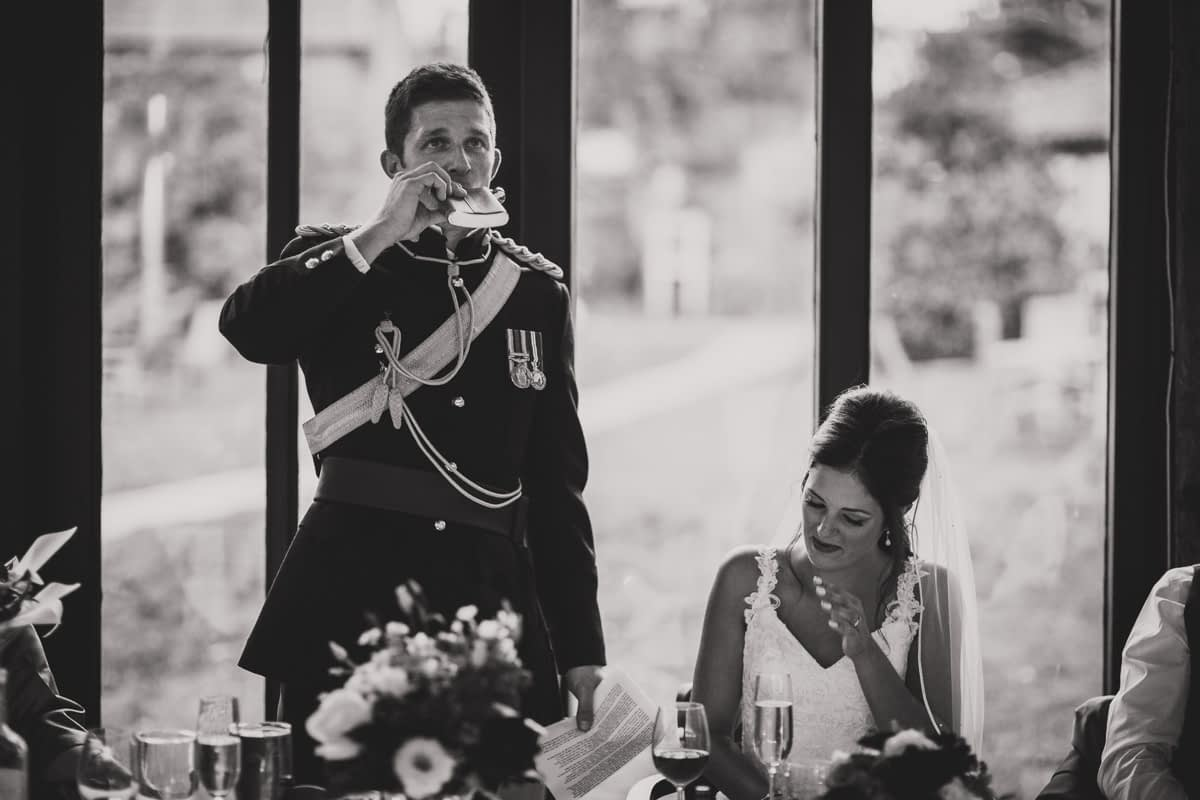 groom drinking from hip flask