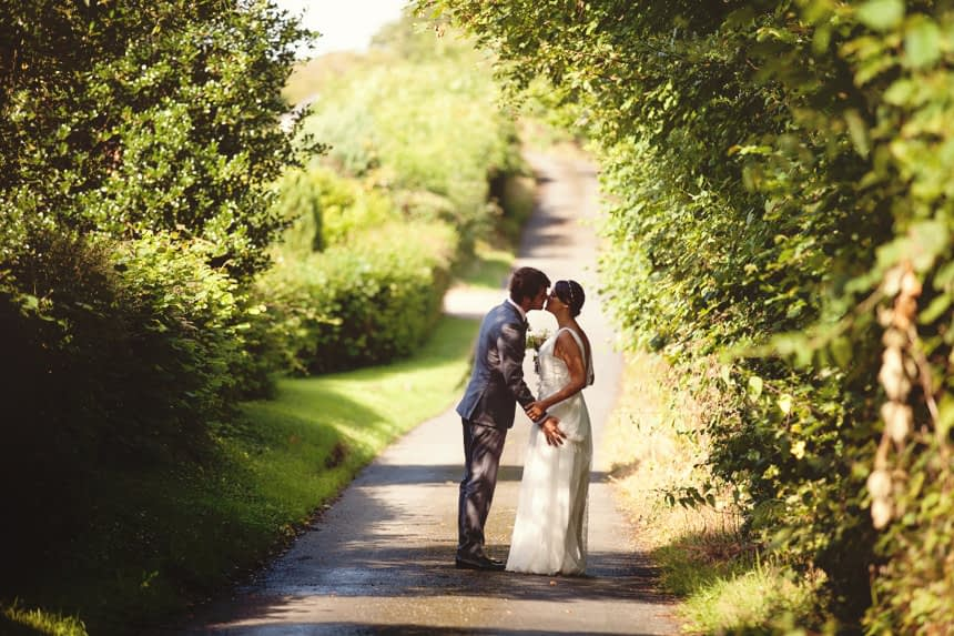 couple kissing in a lane