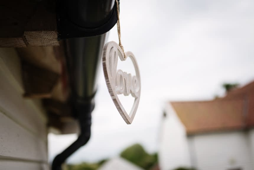 Love sign hanging from gutter