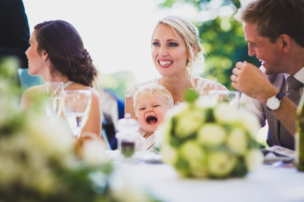 bride and groom's son laughing