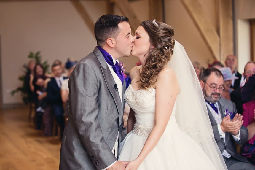 bride and groom kissing wide shot