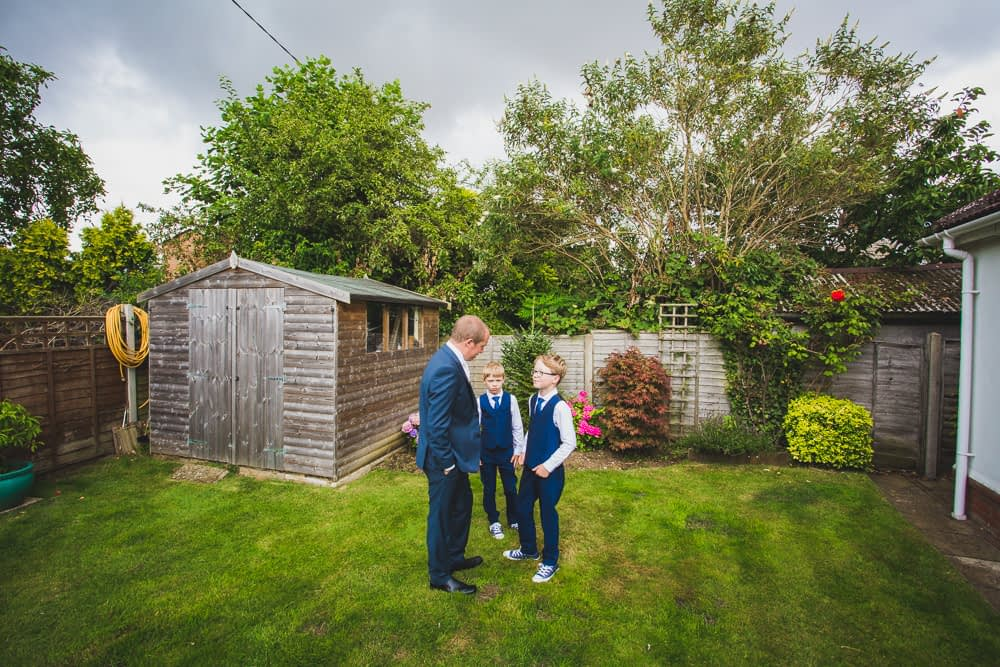 groom with sons in garden