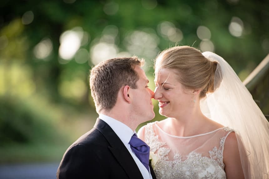 bride and groom touching noses