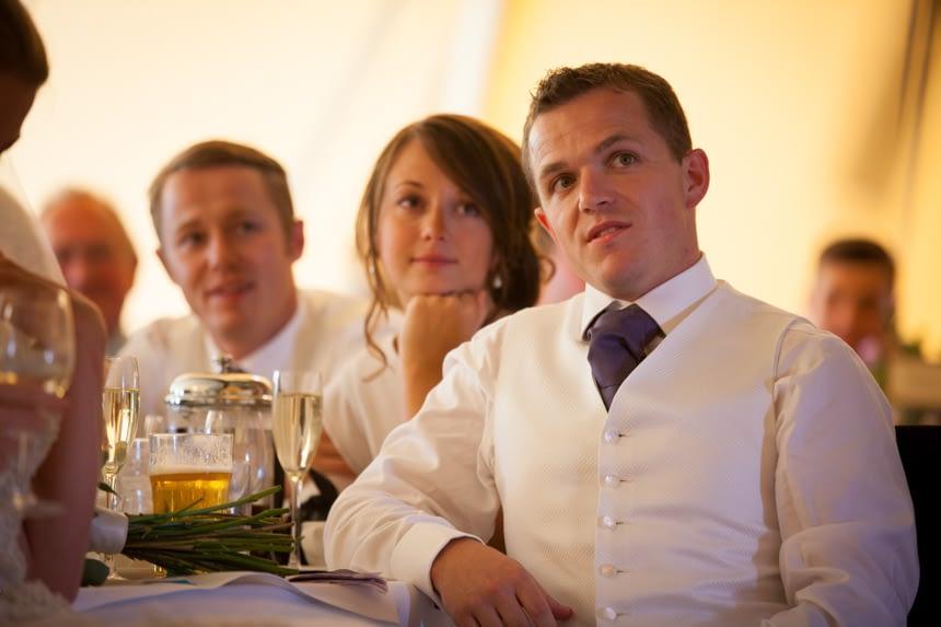 groom listening intently