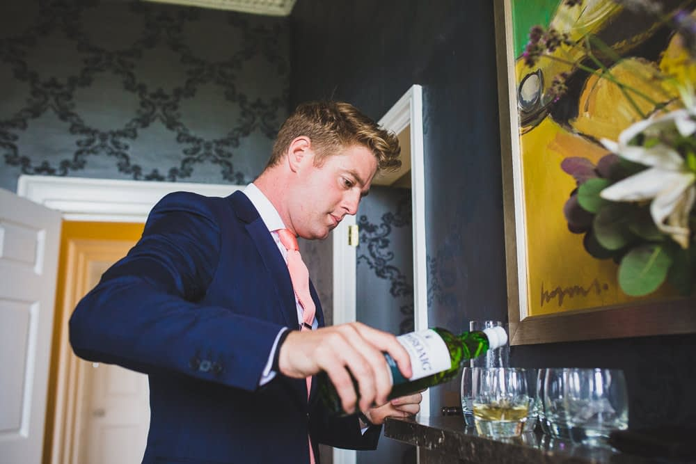 best man pouring scotch