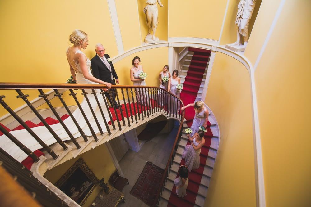bridal party walking stair case at Sibton Park