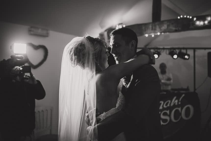 bride and groom hugging during first dance