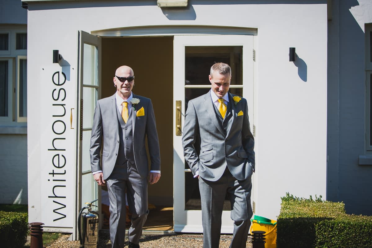 groom and his brother walking
