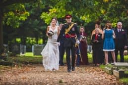 bride and groom walking out of church yard