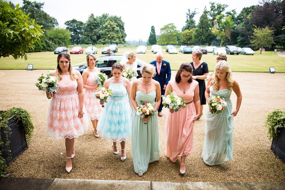 bridesmaids walking up steps to Kimberly Hall