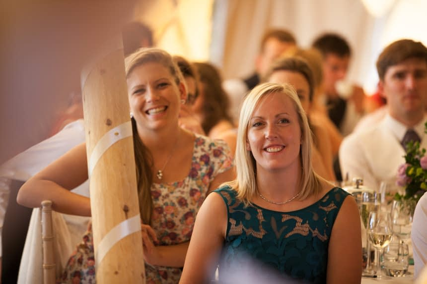 guest smiling during speeches