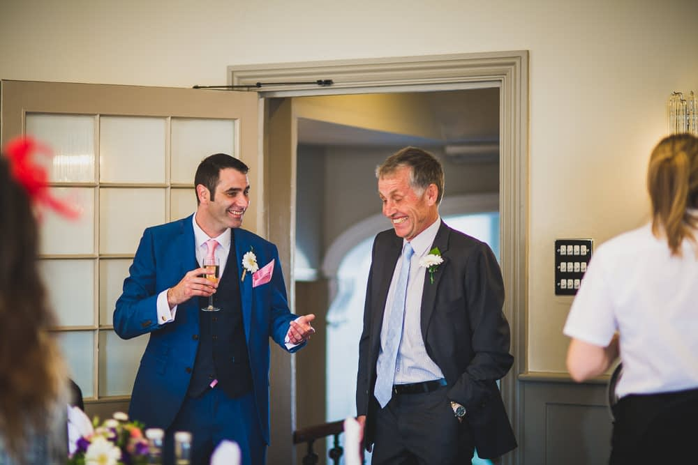 groom and guest laughing