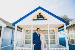 couple standing under beach hut