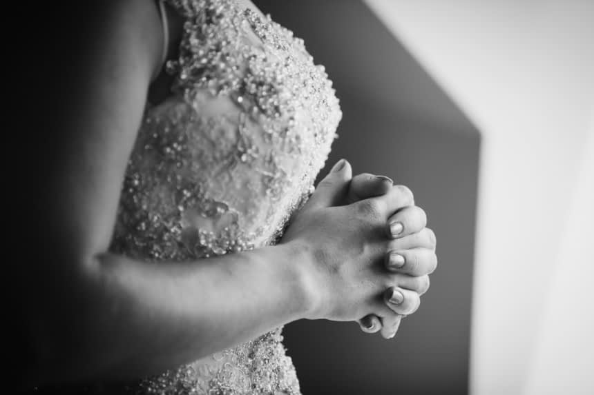 bride clasped hands