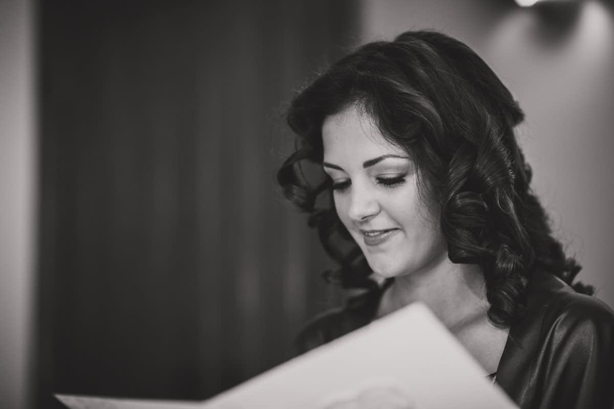 bride reading card from groom