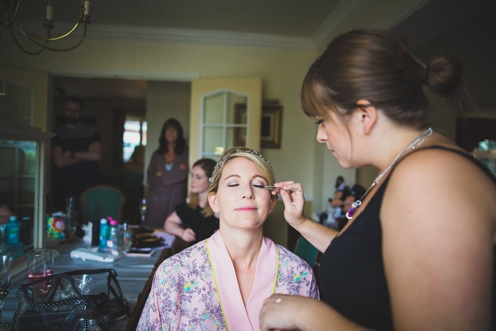 bride having eye make up done