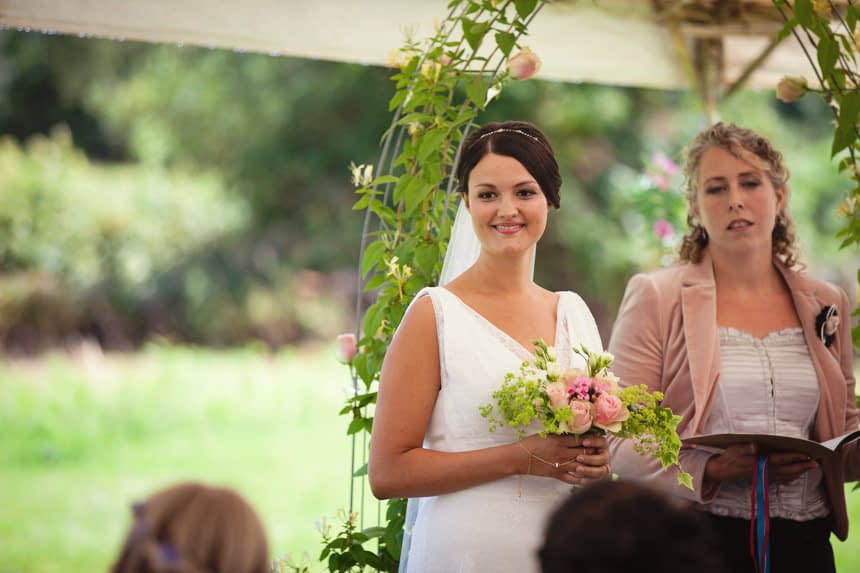 bride standing at front of ceremony