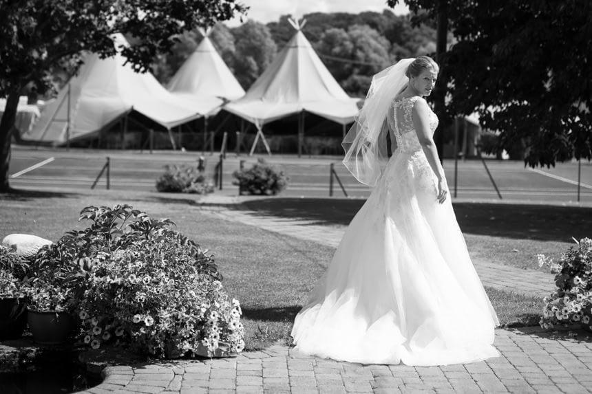 black and white bride outside full length shot